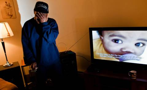 Lavandis Hudson's father, Herbert Hudson, is overcome while watching a video of Lavandis in his Blue Island apartment. Police arrested Lavandis' mother, Marles Blackman, 37, of Calumet Park, on first-degree murder on Feb. 29, 2012.