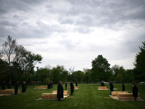 Funeral directors participate in a burial ceremony for 13 indigent adults and 120 fetuses at Mount Olivet Catholic Cemetery in the Mount Greenwood neighborhood. The ceremony, held by the Catholic Archdiocese of Chicago, helped reduce the number of unclaimed bodies at the Cook County morgue. Go here to read our story.