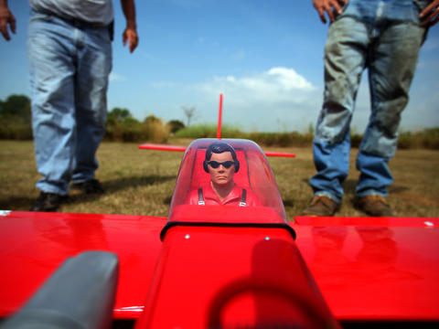 A remote-control plane is positioned for takeoff in an airfield at Waterfall Glen Forest Preserve in Darien. The Woodland Aero Modelers meet there regularly to fly model aircraft, thanks to a deal with the DuPage County district. Click here to watch a video on the Woodland Aero Modelers.