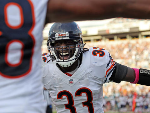 Cornerback Charles Tillman celebrates his interception return for a touchdown in the third quarter of the Bears' 41-3 victory against the Jacksonville Jaguars in Florida. Click here to see more photos from the game.