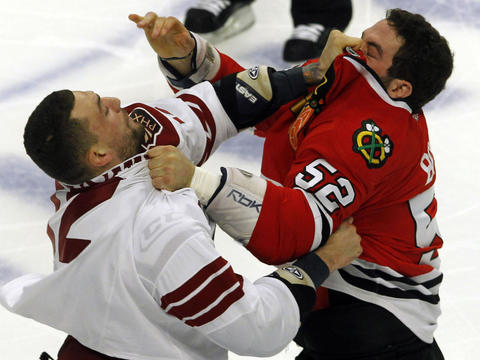 The Coyotes' Paul Bissonnette and the Hawks' Brandon Bollig fight during Game 4 of the teams' first-round Stanley Cup playoff series. The Coyotes won the game 3-2 in overtime. Go here to read more about the game.