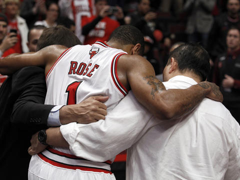 Bulls point guard Derrick Rose is helped off the court by trainers Fred Tedeschi, left, and Jeff Tanaka after suffering a season-ending injury in a playoff game against the 76ers. Go here to read more about the game.