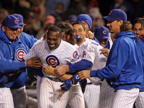 "Cubs left fielder Alfonso Soriano and teammates celebrate his winning hit in the 10th inning against the Cardinals. He said playing on a young team ""makes me happy."" Click here to read more about the game."