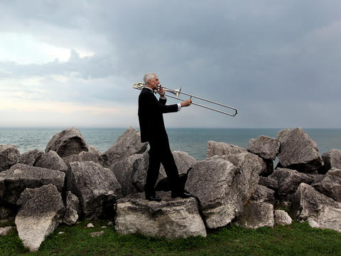 Rick Wunder, of Evanston, plays his trombone near the Lake Michigan shoreline in late March. Wunder, 60, participated in a Northwestern University study that found playing musical instruments at least three times a week into adulthood has a positive impact on the brain. Go here to learn more about the study.