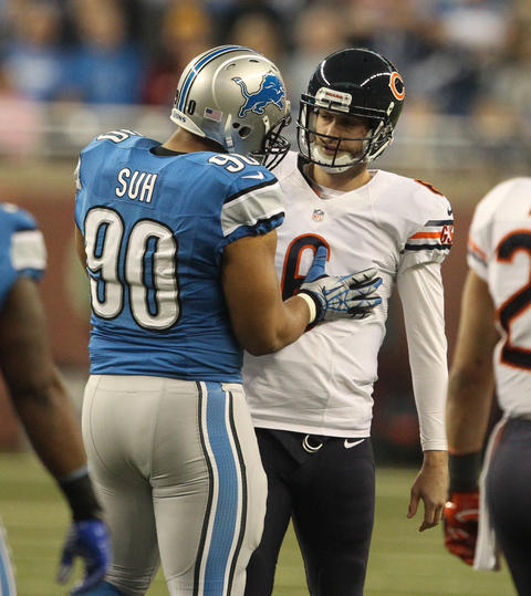 Bears quarterback Jay Cutler has a close encounter with Lions defensive tackle Ndamukong Suh during the first quarter.