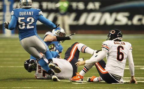 Quarterback Jay Cutler fumbles during the first quarter.