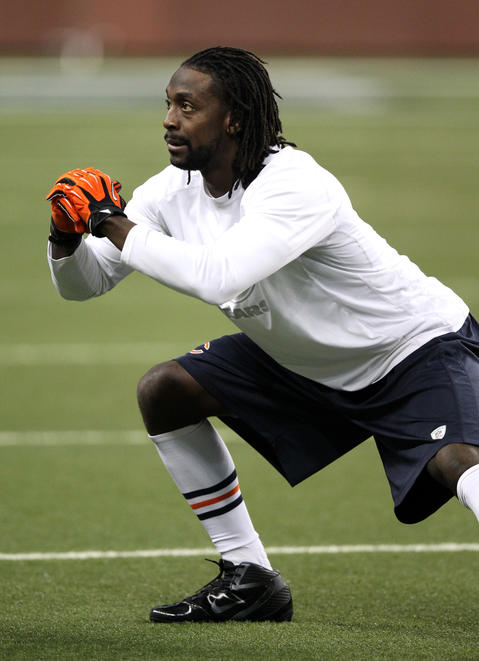 Charles Tillman warms up before the game.