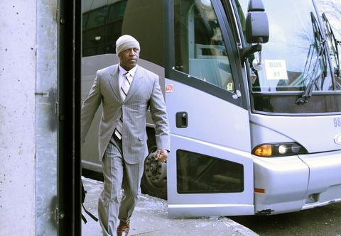 Bears coach Lovie Smith arrives for his team's final regular season game.