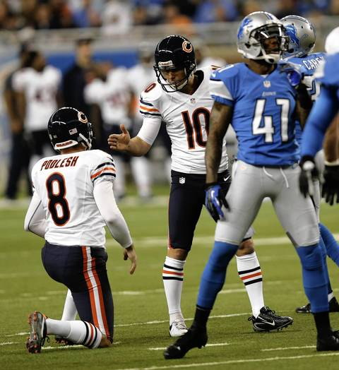 Bears kicker Olindo Mare celebrates with Adam Podlesh after a first quarter field goal.