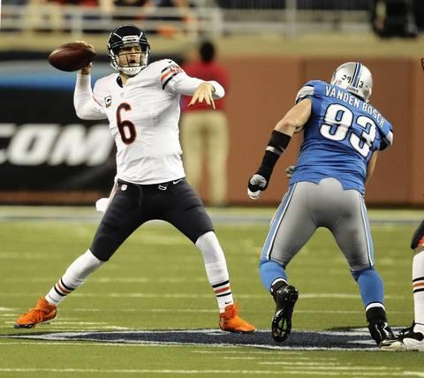 Jay Cutler is pressured by Lions defensive end Kyle Vanden Bosch during the second quarter.