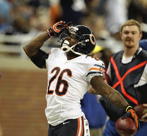 Tim Jennings celebrates his interception against the Lions during the second quarter.