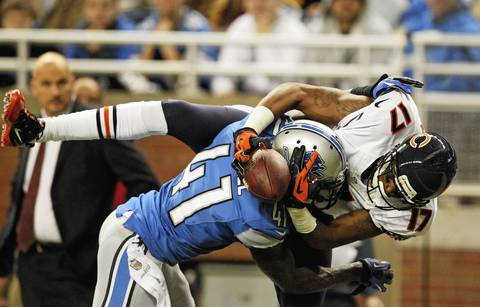 Lions cornerback Ron Bartell break up a pass intended for wide receiver Alshon Jeffery in the end zone during the second quarter.