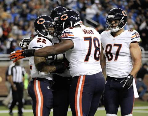 Matt Forte is congratulated by James Brown after scoring a touchdown in the second quarter.