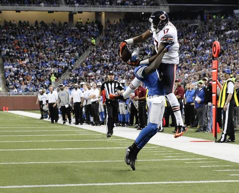 Wide receiver Alshon Jeffery can't pull in a pass the Lions' Ron Bartell defends in the second quarter.