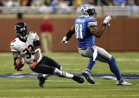 Charles Tillman nearly makes an interception in the third quarter against the Lions.