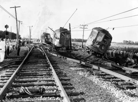 A North Shore train derailed near Chickory Road crossing, south of Racine, Wis., after hitting a car and killing the driver on August 21, 1952. All five cars left the track, one overturning. Sixty-five train passengers were injured.