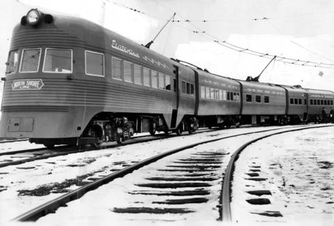 The Electroliner was a four car articulated train that was placed into service by the North Shore line early in 1941, between Chicago and Milwaukee, seen here in January of 1941. It was said to be the most luxurious interurban electric train in the country during its day. The high speed train was painted dark green with red stripes, seated 120 passengers, and came complete with a small tavern lounge.