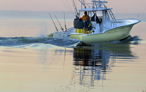 Fishermen bundled against the cold make their way out of Deep Creek onto the James River in Newport News on a fishing trip early Tuesday. Freezing temperatures and a light frost greeted those venturing out early Tuesday morning, but neither deterred these fisherman.