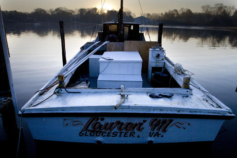 "The ""Lauren M"" rests at it's berth in a layer of frost on Deep Creek in Newport News early Tuesday morning. Freezing temperatures left a thin layer of frost and a thin skim of ice on the creek early Tuesday."
