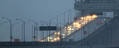 Gloomy driving conditions meet commuters crossing the James River Bridge early Tuesday morning.