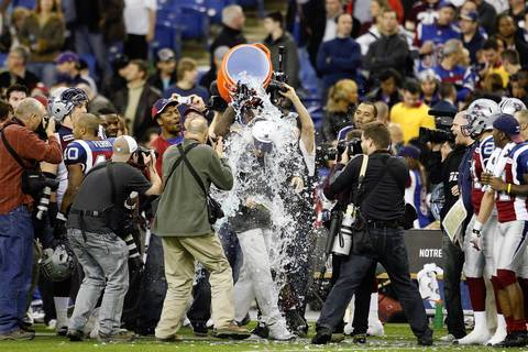 Montreal Alouettes Head Coach Marc Trestman gets soaked by his players during the CFL Eastern Finals game against the Toronto Argonauts at the Olympic Stadium in Montreal, Quebec, Canada.