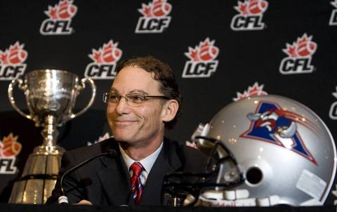 Montreal Alouettes coach Marc Trestman smiles during a news conference in Montreal. The Alouettes are set play the Calgary Stampeders in the CFL's 96th Grey Cup football game.