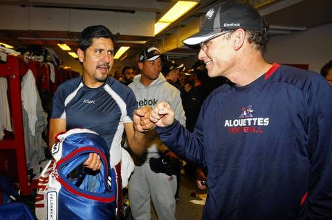 Montreal Alouettes quarterback Anthony Calvillo gets congratulated by head coach Marc Trestman after they defeated the Saskatchewan Roughriders 28-27 in the 97th Grey Cup game at McMahon Stadium.