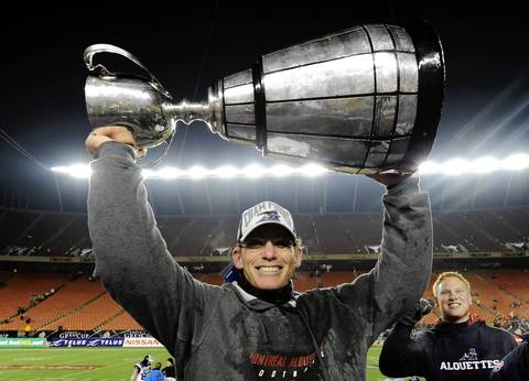 Montreal Alouettes' head coach Marc Trestman holds up the Grey Cup after defeating the Saskatchewan Roughriders during the CFL's 98th Grey Cup football game in Edmonton, Alberta.