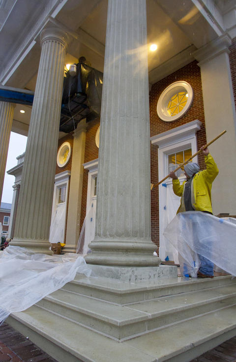 Workers clean the exterior of Pope Chapel at Christopher Newport University early Thursday. The 14,000-square foot structure is scheduled to open this month and is located between the Trible Library and Ferguson Center for the Arts.