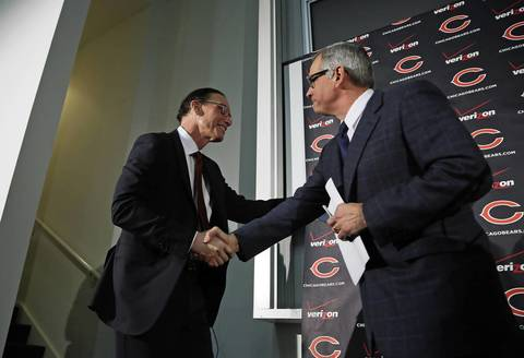 Marc Trestman, left, shakes hands with Bears general manager Phil Emery after being introduced as the new Chicago Bears head coach.