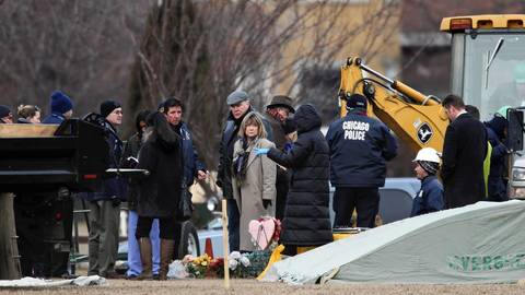 Law enforcement and medical officials prepare to exhume the body of Urooj Khan at Rosehill Cemetery in Chicago.