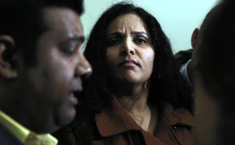 Mohammed Zaman, left, Urooj Khan's brother-in-law, speaks about Khan's death while Meraj Khan, Zaman's wife, looks on at the Daley Center. Meraj Khan expressed ambivalence about the exhumation of her brother's body.