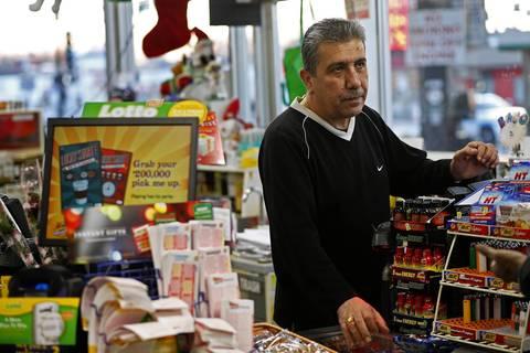"Clerk Ashur Oshana sold Urooj Khan the $1 million winning lottery ticket in June. ""He was jumping up and down,"" Oshana said."