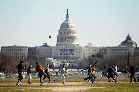 People play football on the National Mall in front of the U.S. Capitol before the Presidential Inauguration.
