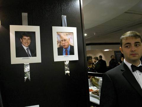 Pictures of former governor Rod Blagojevich and current Gov. Pat Quinn hang near food stations at the Illinois Inaugural Gala at the Renaissance Washington Hotel in Washington D.C.