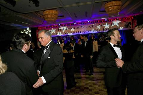 U.S. Transportation Secretary Ray LaHood, second from left, socializes with Illinois State Society President and U.S. Rep. Aaron Schock (left), at the Illinois Inaugural Gala at the Renaissance Washington Hotel in Washington D.C.