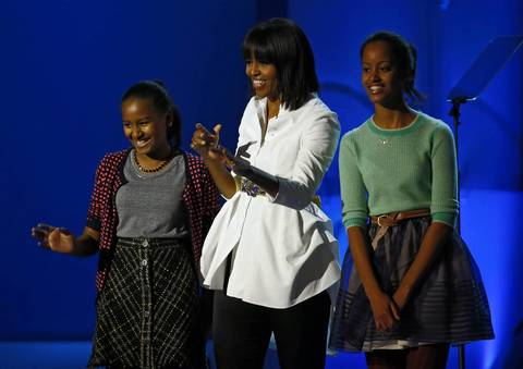 Sasha, Michelle and Malia Obama wave to the crowd during the Kids' Inaugural Concert event at the Washington Convention Center.