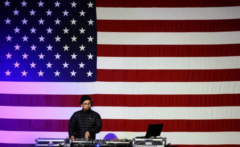A DJ plays music during a National Day of Service kickoff event on the National Mall.