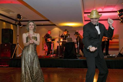 Attendees Sue Sandridge and Dennis Moore dance to the band Southern Wind in one of the rooms at the Illinois Inaugural Gala at the Renaissance Washington Hotel in Washington D.C.