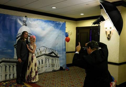 Dan Hauser and Molly Ludden have their pictures taken next to a Capitol backdrop at the Illinois Inaugural Gala at the Renaissance Washington Hotel in Washington D.C.