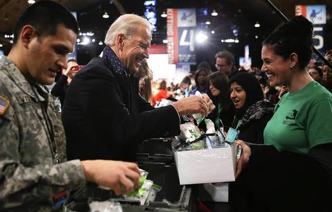 Vice President Joseph Biden chats with volunteers as he participates during a Unite America in Service event on the National Day of Service as part of the 57th Presidential Inauguration at the D.C. Armory in Washington. Vice President Biden and his family joined volunteers to pack care kits filled with necessities for deployed U.S. Service Members, Wounded Warriors, Veterans and First Responders.