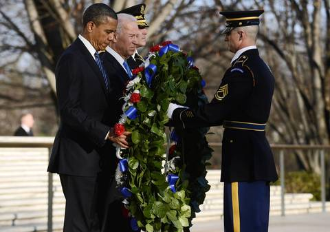 President Barack Obama, Vice President Joe Biden and Major General Michael S. Linnington lay a wreath at the Tomb of the Unknown Soldier at Arlington National Cemetery in Arlington, Virginia, before being sworn in for their second term in office.
