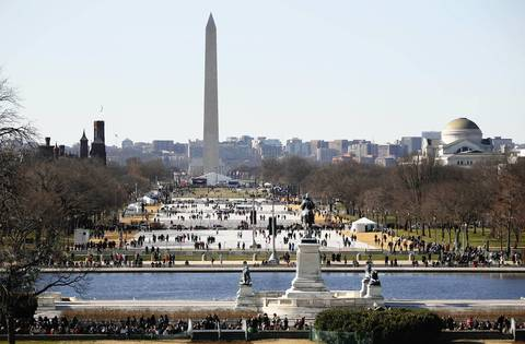 The National Mall is busy one day before the ceremonial inauguration of President Barack Obama.