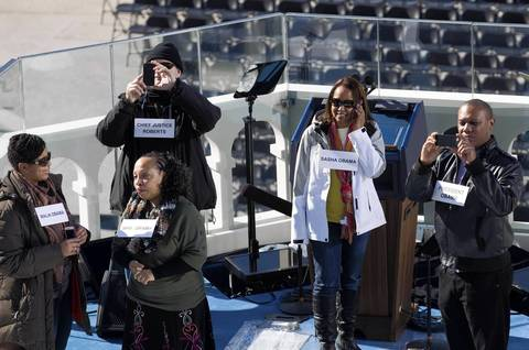 Stand-ins help with the staging of the presidential inauguration in Washington.