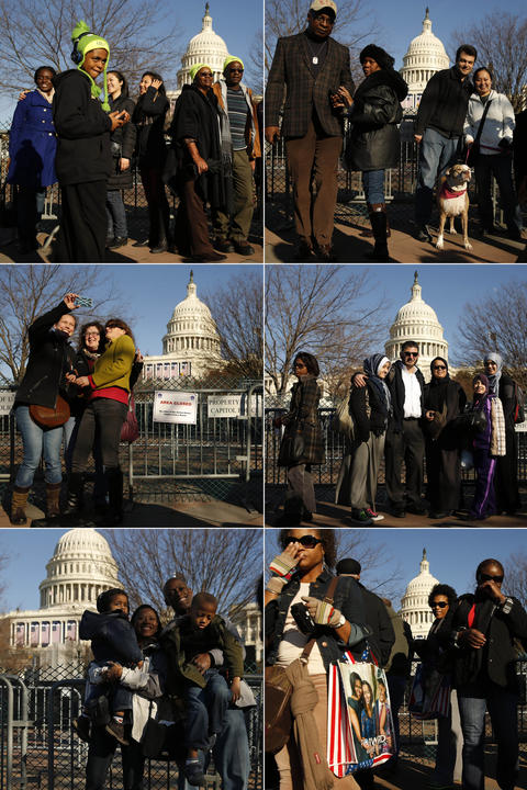 Tourists take turns posing for photos in front of the U.S. Capitol the day before Obama's inauguration.