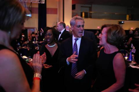 Chicago Mayor Rahm Emanuel shouts to be heard while talking to Pam Cullerton, wife of Illinois Senate President John Cullerton, at Illinois Presidential Inaugural Ball in Washington D.C.,