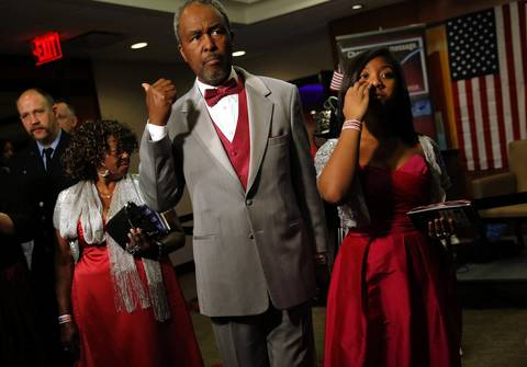 People explore different rooms at the All American Ball in Washington D.C.