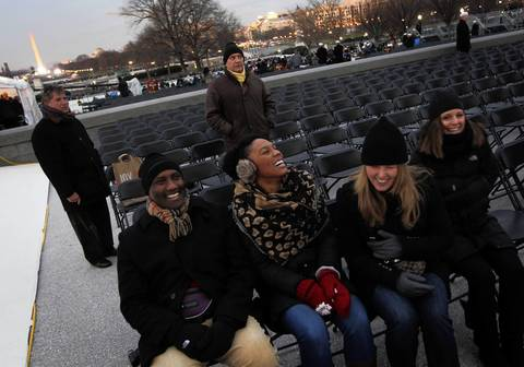 George Nichols, Courtney Nichols, Elizabeth Stulga and Liz Oldenburg are some of the first people to find their seats after arriving at 6 a.m. before the ceremonial inauguration of President Barack Obama at the U.S. Capitol.