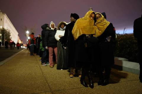 Crowds wait in line for the ceremonial inauguration of President Obama at the U.S. Capitol in Washington, D.C.