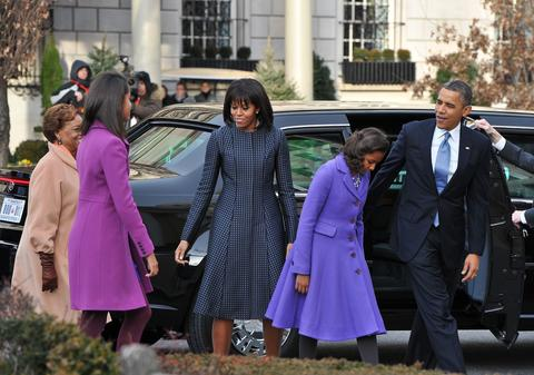 President Barack Obama, first lady Michelle Obama and their daughters, Sasha and Malia, arrive at St. John's Church in Washington, DC, hours before Obama participates in a ceremonial swearing in for a second term in office at the U.S. Capitol.